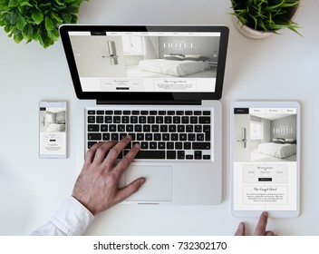 office tabletop with tablet, smartphone and laptop showing cool hotel responsive design website