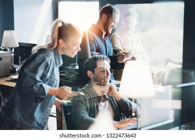 Office teamwork situation. Group of people talking and working on daily general tasks in the workplace