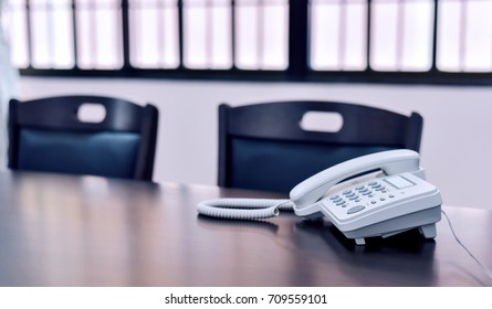 Office telephone on table,telephone on table with blur library room background