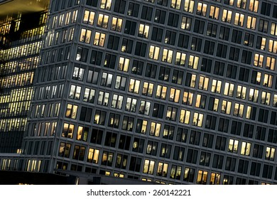 office tower with illuminated windows at night