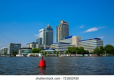 Office towers on the Amstel river in Amsterdam