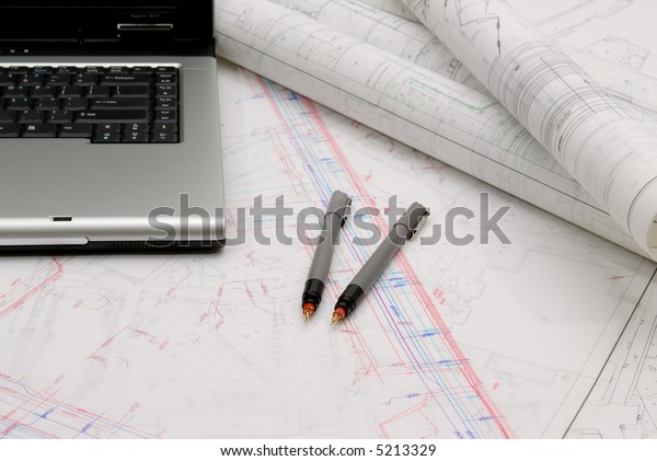 Office utensils and maps on the table