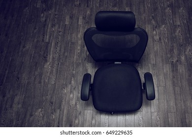Office vacant black chair top view on wooden surface with empty space