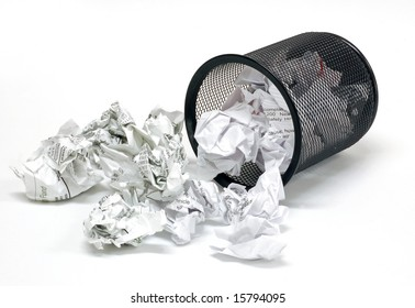 Office wastebasket and paper on a white background