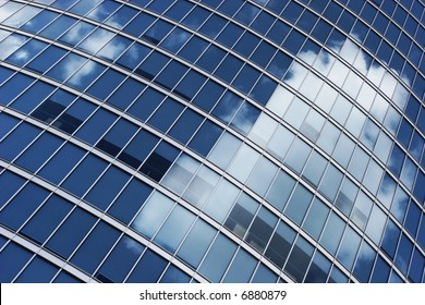 Office windows with a clouds reflection