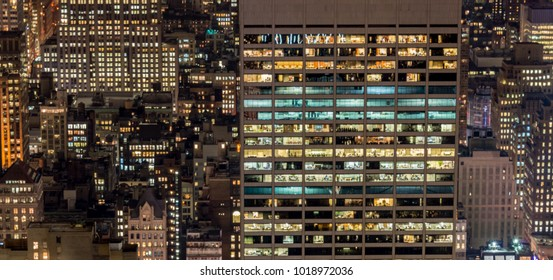 Office windows illuminated at night
