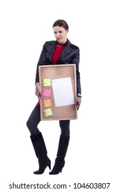 Office woman in black suit and high heel boots holding a plywood board with empty color notes and a lettersize plain paper for a to do list