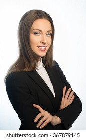 Office woman in a jacket with long hair, smiling