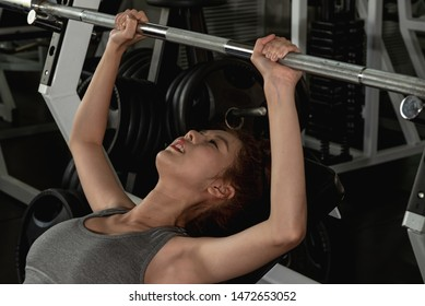 Office woman lifting weights in the sport gym ,body building and loose weight concept.
