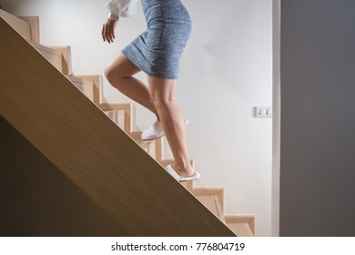 Office woman walk on stairs