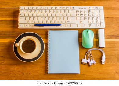 Office wooden table with notepad,Pen, keyboard,mouse,Phone charg