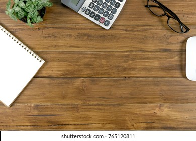 Office work table with tablet , notebook and stationary on brown wood desk table , Topview with workspace for add text or graphic