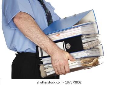 office worker is carrying some heavy folders