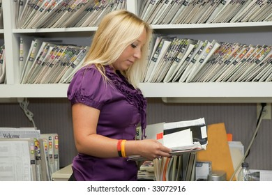 Office worker checking medical record in office. O