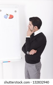 office worker (consultant) giving a presentation on a flipchart. Studio shot on a white background.