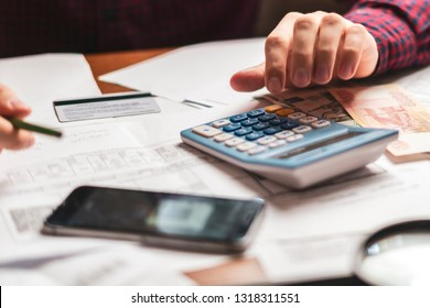 office worker counting company earnings with a calculator