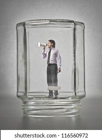 Office worker, in a glass container, screaming