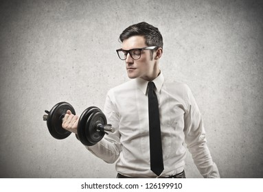 Office worker with glasses raising a dumbbell