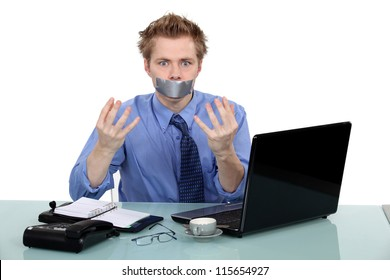 Office worker with his mouth taped shut