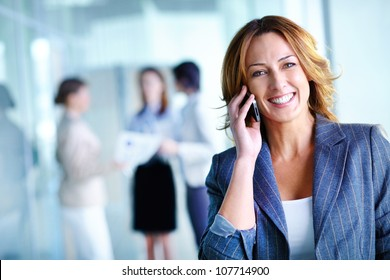 Office worker making a phone call understanding the importance of positive attitude