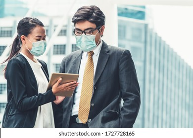Office worker meeting with face mask quarantine from coronavirus or COVID-19. Concept of protective working environment to reopen business and stop spreading of coronavirus or COVID-19.