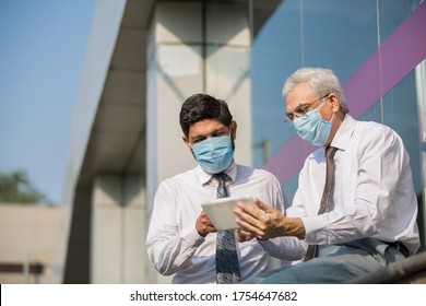Office worker meeting with face mask quarantine from coronavirus or COVID-19