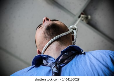 Office worker with noose around neck. Suicide concept. Hanging because of work stress. Depression of burnout. Terrible life situation.