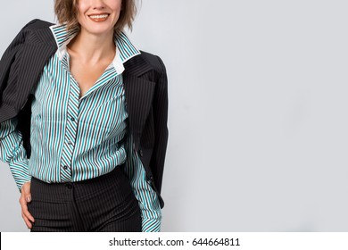 Office worker. Photo working woman in suit over grey background