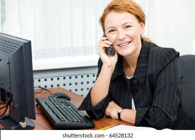 Office worker posing for camera indoor