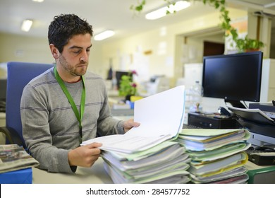 Office worker reading fies at office