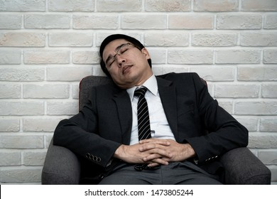 Office worker sleeping on chair, Concept of fatigue at work