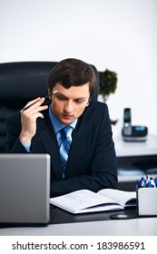 Office worker thinking in office