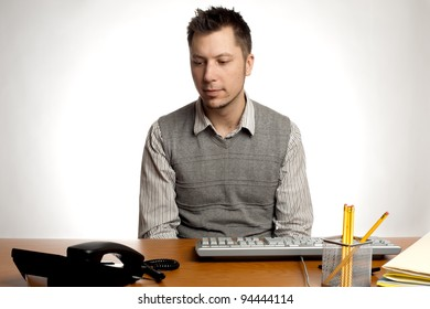 An  office worker waiting for the phone to ring