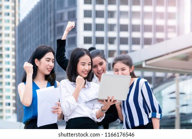Office workers business woman friend is celebrating teamwork on laptop outdoor