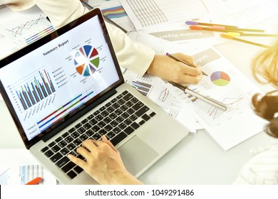 Office workers busy working, Business strategy planning, Business women discuss and review data documents, Business chart and graph analyzing.