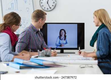 Office workers during business conference on the skype
