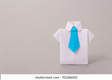 Office workers in a shirt and tie made of paper. Origami. Copy space for text.
