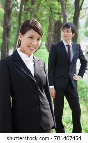 Office workers in the tree-lined street