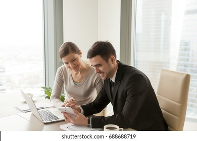 Office workers using digital tablet and laptop sitting at desk, colleagues happy to work with company-issued devices, mobile solutions for business management system, apps for enterprise optimization