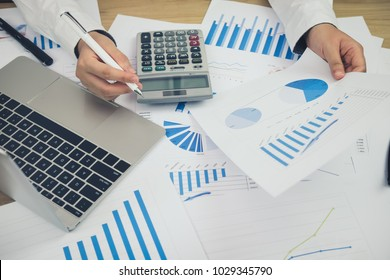 Office workplace with business finance, accounting,laptop on wood table.finance statistics and analytic research concept