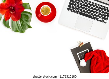 Office workplace with coffee and red Christmas decoration. Flat lay for social media