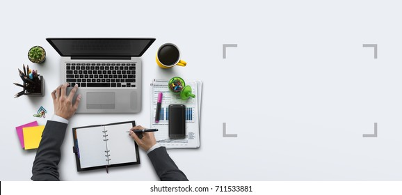 Office workplace with laptop, notebook, hand, office supplies, on white background. Solution, business planning, financial analysis, accounting, start up or working flat lay top view concept.