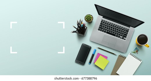 Office workplace with laptop, notebook, office supplies and stationery on turquoise background. Solution, business planning, creative, design, learning, start up or working flat lay top view concept.