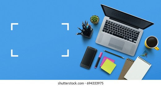 Office workplace with laptop, notebook, office supplies and stationery on blue background. Solution, business planning, creative, design, learning, start up or working flat lay top view concept.