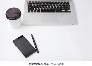 Office workplace with laptop and smart phone