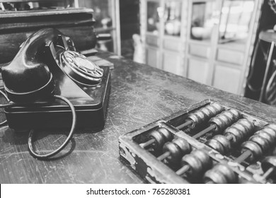 Office workplace with vintage telephone with calculator or abacus. financial inspector and secretary making report, calculating balance. Internal Revenue Service checking document. Audit concept