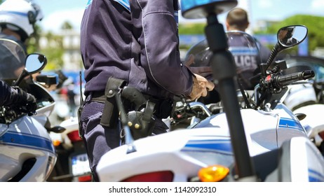 Officer of motorbike police patrol on duty to maintain public order in big city