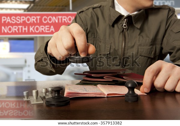 Officer of the state border guard service of North Korean. Passport control.