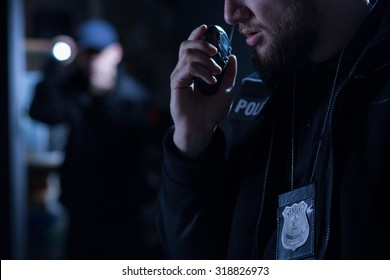 Officer using walkie talkie during police intervention