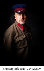Officer of the USSR Army. officer of the Soviet army against the background of the flag of the USSR.